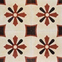 delle piastrelle di color bianco con i disegni di fiori di color marrone e nero
