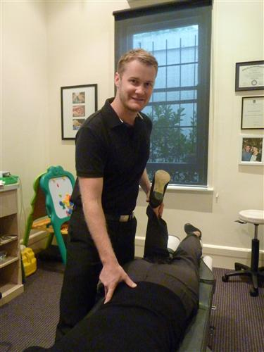 rose family chiropractic experienced chiropractor giving therapy