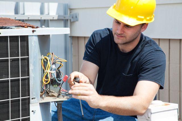 Expert performing heating repairs in La Crosse, WI