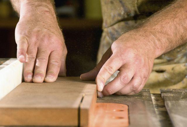 Hands performing antique restoring work in Auckland
