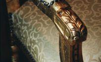 Detail of a golden armchair