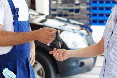 Professional handing the car keys