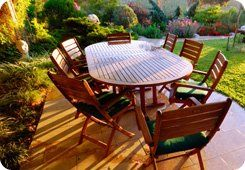 Hedging - Greater Manchester - Collins Landscapes Ltd - garden with table and wooden chairs