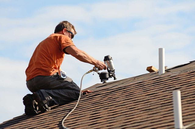 One of our roofing experts working on a roof in Columbus, OH