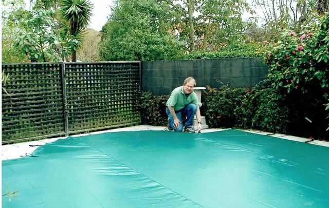 man beside pool