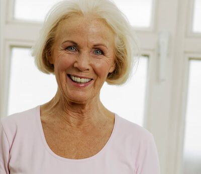 smiling lady with new dentures