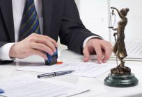 Attorney signing paperwork for the personal injury case in Harrison, OH