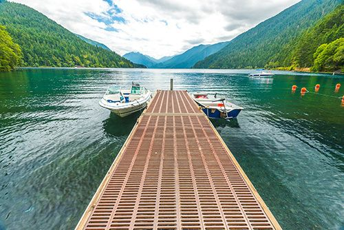 Newly constructed dock with boats secured in Dayton, MT