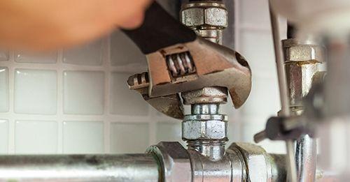 Plumber repairing pipes in Charlotte, NC