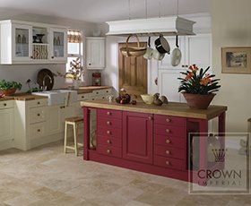 Shaker style kitchen with units in cream and aubergine