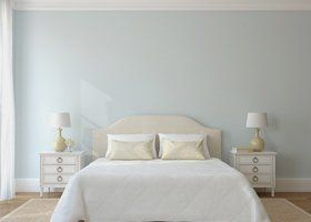 tranquil white bedroom with double bed