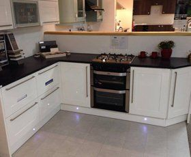 modern kitchen in white with built under cooker