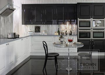 gloss white bianco kitchen with dark flooring and wall units