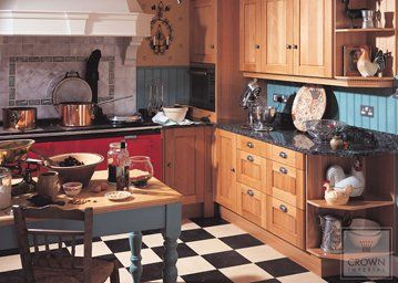 solid oak chartwell kitchen with black and white tiled floor
