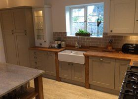 shaker style kitchen with double belfast sink unit