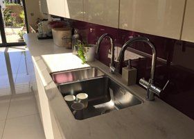modern kitchen with double stainless steel sinks and mixer taps