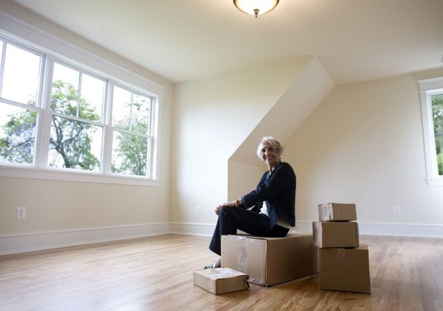 A lady with her belongings packed by careful movers in NZ