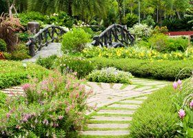 A pretty garden with a bridge