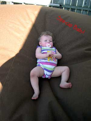 Baby laying on Hot Tub Cover