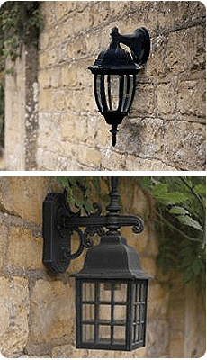 Black ornate outdoor lighting attached to a brick wall