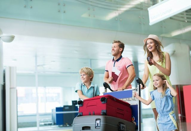 Happy family with a suitcases