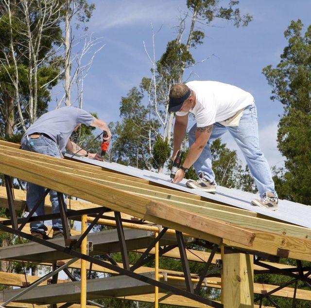 Contractors working on roof restoration in the Bay of Plenty region