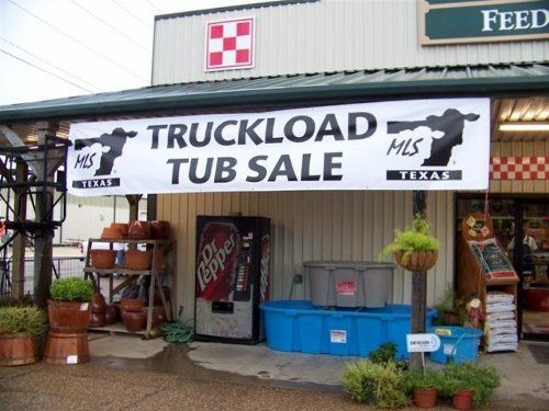 Outside view of truckload tub sale