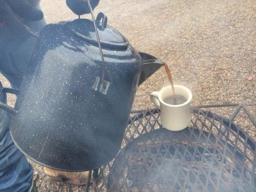 Pouring hot cup of coffee at Clifton, TX
