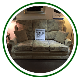 White display sign on a three seater high back sofa
