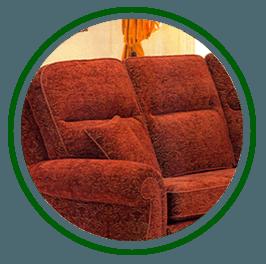 A rust coloured velvet sofa