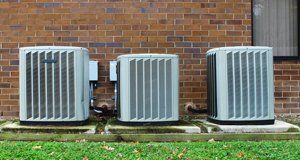 Air conditioning condensers outside a home in Spring, TX