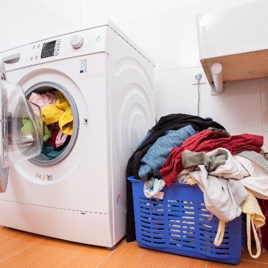 Large pile of laundry waiting to be washed.