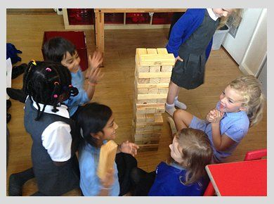 Children playing a giant jenga game