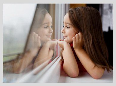 A little girl looking out of a train window