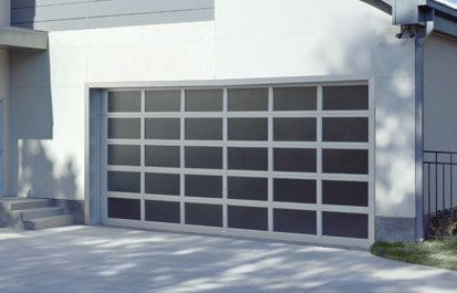 A large garage door in a white house