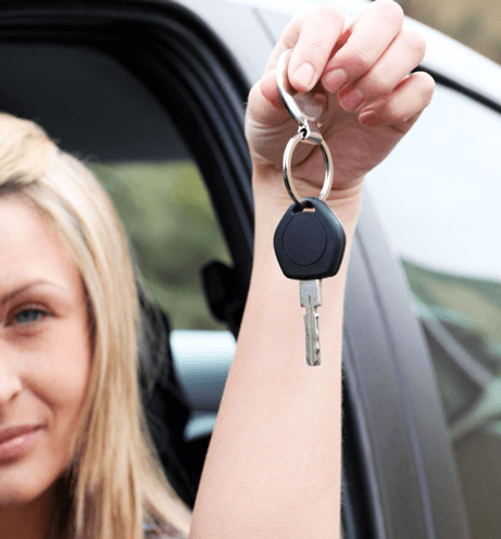 Woman with car key from trained instructors in Rochester, NY