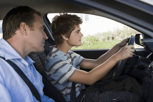 Young learner with auto driving school instructor in Rochester, NY