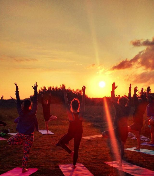Kula yoga outdoor yoga sunset earthing