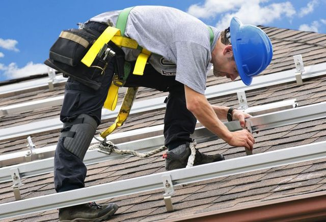 Man installing photovoltaic system