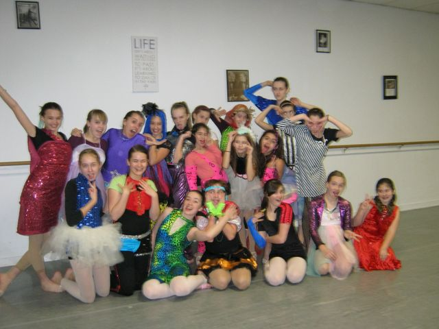 Dance teacher and students in a dance studio in Rochester, NY