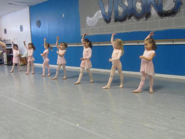 Dancer preforms contemporary dance in a dance studio in Rochester, NY