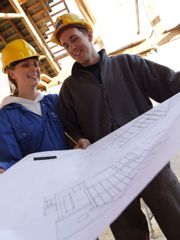 Workers inspecting plans