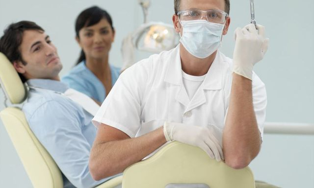 Dentist and patient working on patients good oral hygiene in Winder, GA