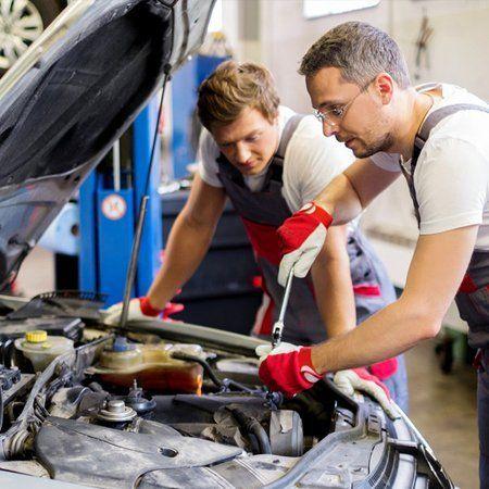 mechanics checking vehicle