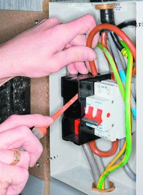 Electrical services - Palgrave, Norfolk - electrician working on an electrical fuse box - DAVID PEACHEY ELECTRICAL AND MECHANICAL