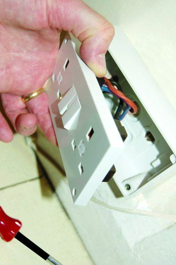 Electrical services - Palgrave, Norfolk - electrician working on a light switch - DAVID PEACHEY ELECTRICAL AND MECHANICAL