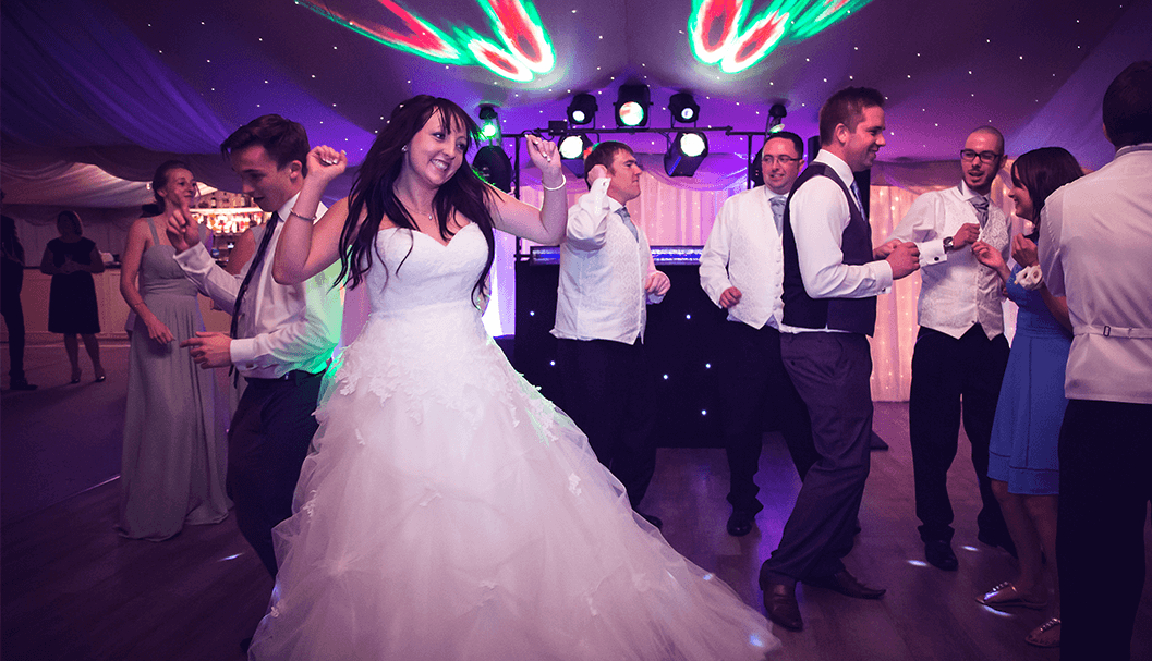 bride dancing surrounded by people