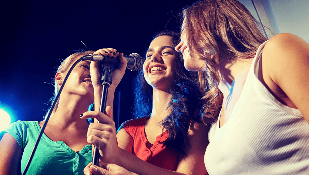 3 girls doing karaoke