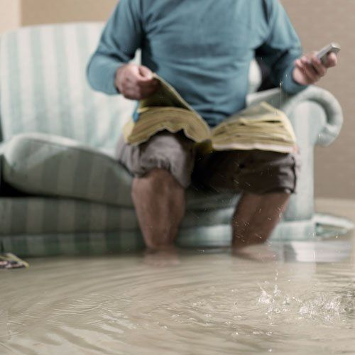 Man in flooded home