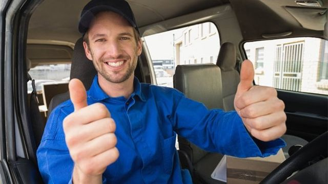 man win car with thumbs up